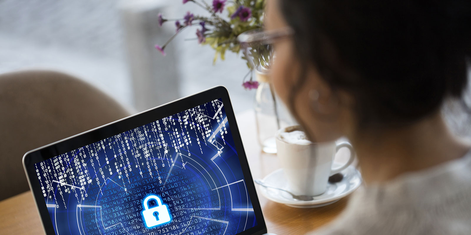 Woman looking at laptop with a lock symbol displayed