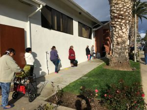 People in need line up to get food from the San Diego Food Bank during the COVID-19 pandemic