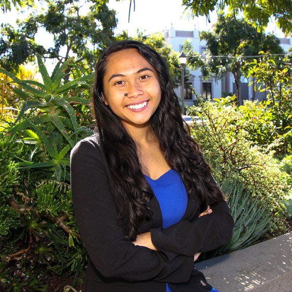 First year USD student Harmony Prado poses and smiles