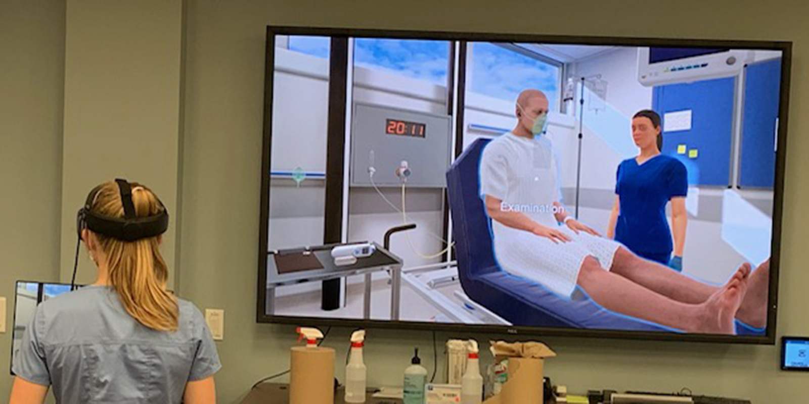 USD nursing student using virtual reality headset to treat a virtual patient