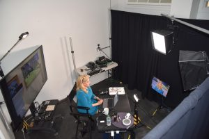 Cynthia Alksne preparing to go on-air from her home studio.