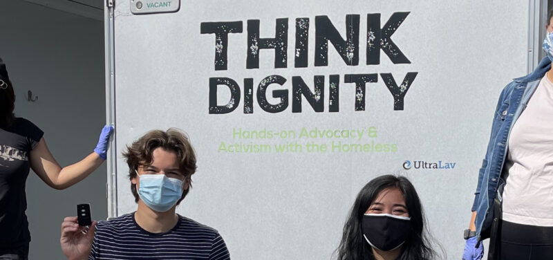 USD Students in front of the Think Dignity mobile showers truck